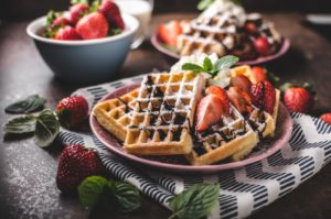 Waffles with chocolate dressing and strawberries