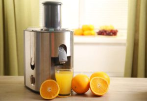 Large Juicer Juicing Oranges