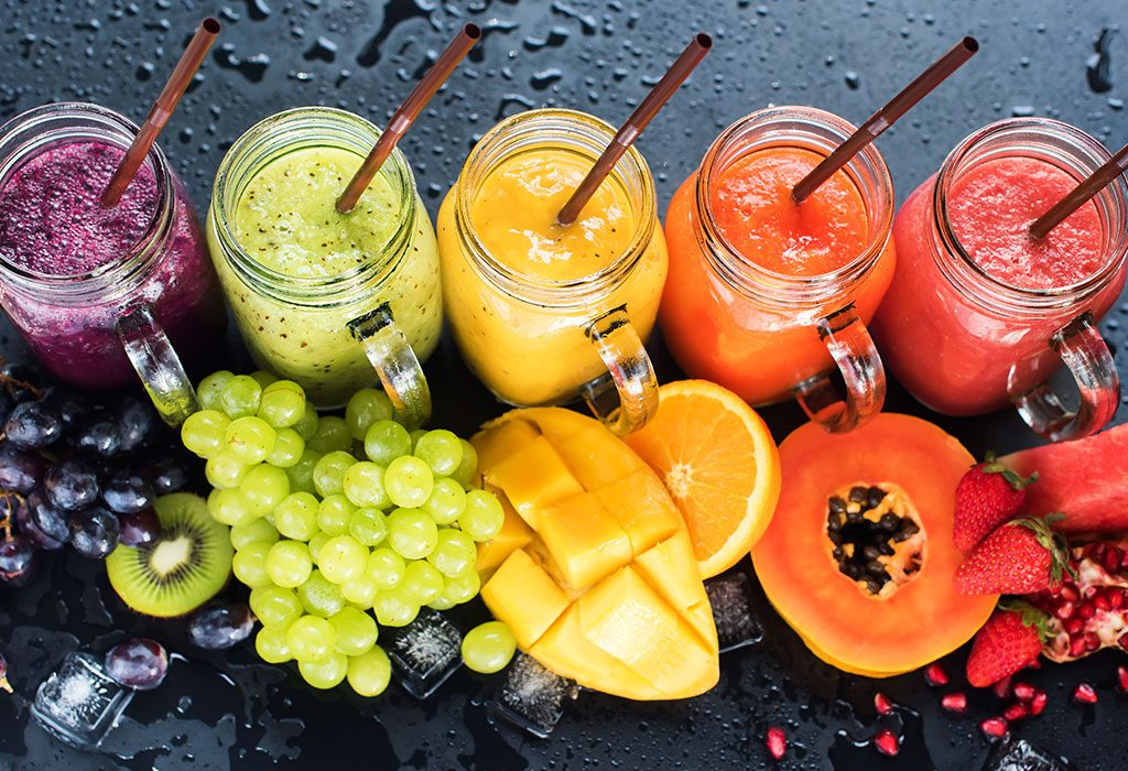 A collection of fruit smoothies made from different fruits
