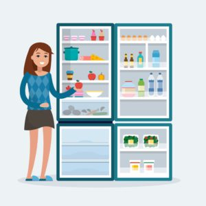 Lady standing next to open fridge
